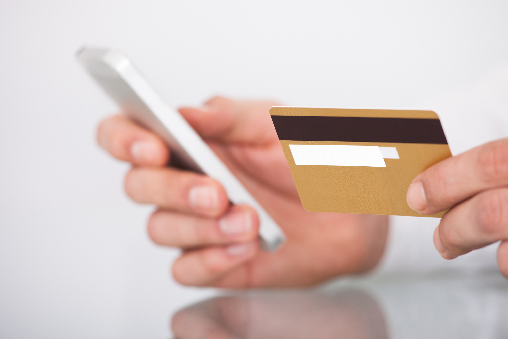 Man Shopping With Credit Card And Mobile Phone