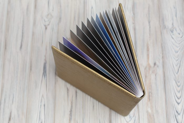 Open leather photo book with wooden background.